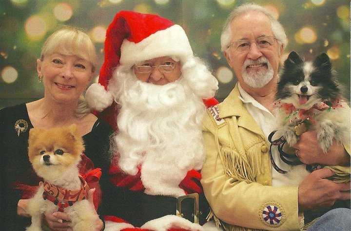 Bella Pomeranian with Buddy, their pawrents, and Santa